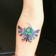 I love Zelda & watercolor tattoos. This is perfection!