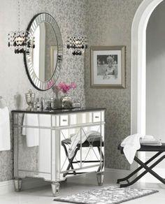 A glamorous transitional bathroom | bath lighting, mirrored furniture, chrome
