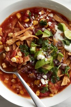 NYT Cooking: This vegetarian version of tortilla soup is no less complex than its chicken counterpart, thanks to plenty of vegetables, spices and a se. Vegetarian Tortilla Soup, Vegetarian Recipes, Vegetarian Chili, Vegetarian Lunch, Soup Recipes, Cooking Recipes, Fruit Recipes, Salad Recipes, Parmesan Soup