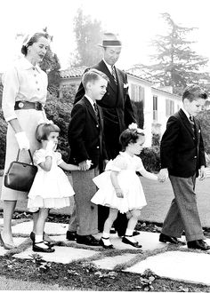 Classic actor; classic man. Jimmy Stewart leaves his home on way to Easter church service with his family.