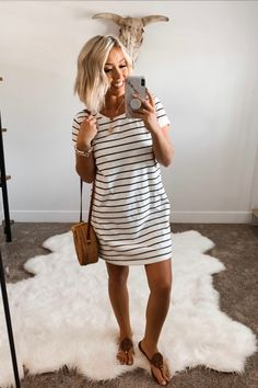 Blissful Days White/Black Striped Dress - Nicoleisapetersen This gorgeous striped dress is a must-have for any afternoon with your BFFs! We love the timeless black and white stripes – it's so chic and easy to dress up or down! Source by shopthepinklily - Striped Dress Outfit, Tshirt Dress Outfit, Winter Skirt Outfit, Casual Dress Outfits, Summer Dress Outfits, Fitted Tshirt Dress, Trendy Outfits, Simple Summer Outfits, Summer Outfits Women