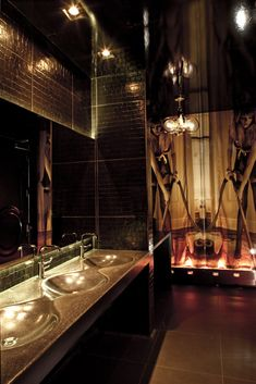 Vanity Night Club Bathroom: wall tiles, art, unique lighting, integrated & connected concrete sinks