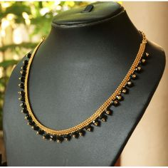 Gold plated chain with black beads. This is a handmade necklace with 6 months colour gaurantee.