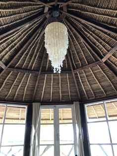 Thatched roof in Bali Roof Ceiling, Ceiling Lights, Thatched Roof, Valance Curtains, Bali, Arch, New Homes, Chandelier, Bathroom