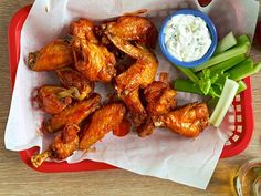 Classic Hot Wings Recipe : Ree Drummond : Food Network: These are wonderful and not too hot!!  Even our 7 year old loves them.   We baked them from frozen according to directions on bag, tossed in the sauce and then baked again for 5 minutes and they were perfect!