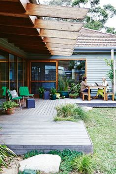 Garden With several seating options, including 'Seb' chairs from Jardan, this deck area is a great spot to...