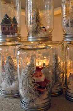 DIY mason jar snow globes, inspired by Anthropologie! Diy Mason Jar Lights, Mason Jars, Pot Mason, Mason Jar Lighting, Mason Jar Crafts, Noel Christmas, All Things Christmas, Vintage Christmas, Primitive Christmas