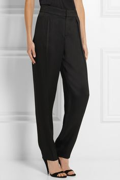 Chloé|Textured-canvas tapered pants|NET-A-PORTER.COMRelaxed silhouettes are key for Chloé's Fall '14 collection. Cut loose on the hips and tapered at the ankle, these high-rise pants are laid-back yet smart. A buckled waist tab means you can adjust the fit.  Black textured-canvas Concealed button, hook and zip fastening at front 87% viscose, 13% wool; lining: 70% acetate, 30% wool Dry clean 725 Euro