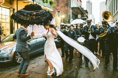 New Orleans wedding tradition: second line | Image by Carolyn Scott Photography
