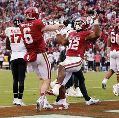 Oklahoma's Baker Mayfield (6) congratulates Oklahoma's Samaje Perine (32) on a touchdown run during a college football game between the University of Oklahoma Sooners (OU) and the Texas Tech Red Raiders at Gaylord Family-Oklahoma Memorial Stadium in Norman, Okla., on Saturday, Oct. 24, 2015. Photo by Steve Sisney, The Oklahoman