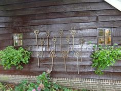 Love hanging garden junk on my fence but now want to hang some carpet beaters too!