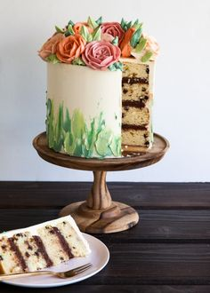 Pretty cake frosting style! Flowers on topped and smeared icing in greens below.