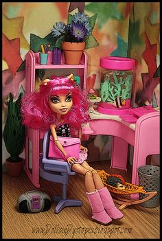Monster High. I bought this same desk for barely nothing on eBay. I want to redo it with mh flair. Give it some mh colors get rid of the Barbie idea. Anyone with any ideas? Blond in pic.