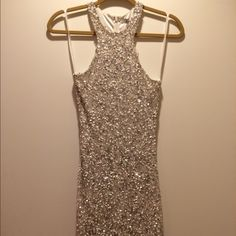 Parker NY Silver Sequin Cocktail Dress Up for sale is a gorgeous NWT cocktail dress from Parker! This dress features a high neck and a t-back. It is adorned with beautiful white and silver sequins and metal rings. Fully lined. Shell is 100% silk, lining is 100% polyester. Retails for $462. Please contact me with questions or requests for additional pictures! Parker Dresses Mini