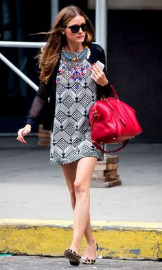 Olivia Palermo in printed dress with red Louis Vuitton bag, & leopard flat shoes