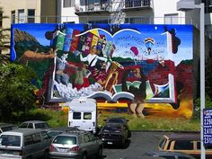 A colorful mural in San Francisco, featuring Chaim Potok's The Chosen, Gabriel Garcia Marquez's 100 Years of Solitude, Maya Angelou's I Know Why the Caged Bird Sings, The Art Book, Cervantes's Don Quixote, J.D. Salinger's Catcher in the Rye, and Douglas Adams's Hitchhiker's Guide to the Galaxy