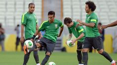 Brazil's forward Neymar (2-L) controls the ball as teammates Lucas (L) and Marcelo (R) look on during a training session in Fortaleza, northeastern Brazil, on the eve of their FIFA Confederations Cup Brazil 2013 Group A football match against Mexico, on June 18, 2013. AFP PHOTO / VANDERLEI ALMEIDA