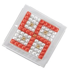 Swastik or swastika is an auspicious symbol of fortune & wellness. It protects you from all enemies and evils. This unique yantra other wise instrument is powered by accurate 729 pyramids in grid of 81. The red swastika grid has 8 copper and one gold plated radiator behind.