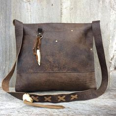 Leather Cross Body Bag in Distressed Brown - Handmade - All Leather - Deer Antler Accents - Lacing - Rustic Style - by Stacy Leigh Handmade leather bag that is hand stitched. It is an all leather bag (unlined). It has one leather pocket inside, and 2 leather pockets on the back, outside #handmadebag