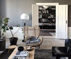 Ilse Crawford The Apartment Residency   Remodelista-sheepskin on Franco Albini's rattan Gala Lounge Chair