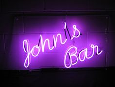 John's-Bar-neon-sign by Neoncreations – purple neon script sign