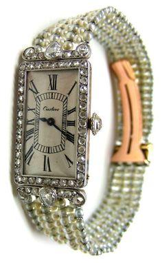Cartier pearl and diamond dress watch, circa 1905. Via Diamonds in the Library.