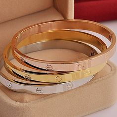 Made from surgical steel with a bright finish, you can customize the Eternal Love Bangle Bracelet with crystals and choose from a silver, gold or rose gold-plated finish. We love stacking all three variations, plus, these make a great gift (they already come packaged in an adorable gift box)!