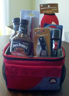 Man basket. GENIUS. I wish it had a link. From what I can tell, it includes a flashlight, a neoprene bottle cover/holder, a pocket knife and barbecue sauce (Jack Daniels style) all put in a cooler :) Can't tell what the thing in the back is though