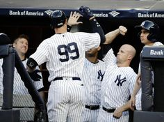 Judge, Yankees batter Orioles 16-3 for 4th straight win  -  June 10, 2017:   New York Yankees' Aaron Judge (99) celebrates with teammates after hitting a home run during the first inning of a baseball game against the Baltimore Orioles, Saturday, June 10, 2017, in New York. (AP Photo/Frank Franklin II)