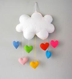 Lindo móbile de nuvem e corações coloridos. Uma chuva de amor. Feito com feltro e enchimento acrílico. Ideal para enfeite de quarto das crianças. Podem ser feitos em outras cores. Aceitamos encomendas. ATENÇÃO: Com o nome em feltro aplicado na nuvem, haverá um acréscimo de R$ 5,00. Caso você... Felt Diy, Felt Crafts, Diy And Crafts, Crafts For Kids, Paper Flowers Diy, Felt Flowers, Felt Banner, Felt Mobile, Initial Jewelry