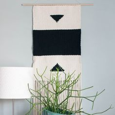"This gorgeous woven tapestry is modern in black and white. It is a large hanging size measuring 15 1/2"" wide x 46"" tall, including the fringes on the bottom. The dowel that it hangs from measures 22"""