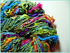 LoveBuzz art yarn, lots of sari ribbon, wool locks and other fibery goodies.