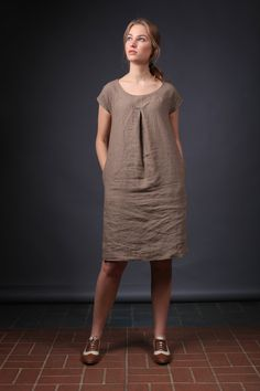 This cosy youthful natural linen dress will impart the felling of freedom and original style for every women who will wear it. The dress is exceptionally comfortable, made from the natural Lithuanian linen.  Each dress is individually cut and sewn for you only.  We hope this dress will be another lovely detail in your daily linen life. ;)  Details: - 100% Lithuanian linen; - medium weight linen; - the dress has two comfortable side pockets; - handmade by LinenCloud; - care: machine wash…