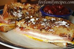 Breakfast Monte Cristos - These are not your average Monte Cristos... they are so much better. Made with maple syrup and vanilla egg dip for the bread.  Inside is black forest ham, fried egg, cream cheese, Swiss cheese, and sprinkled with powdered sugar on top.