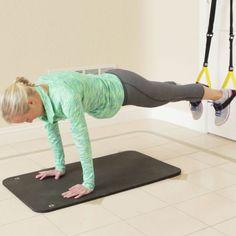 Ready for a truly hard-core challenge? These four exercises you can do with a TRX at home target your entire core, working to flatten your belly and narrow your waist.