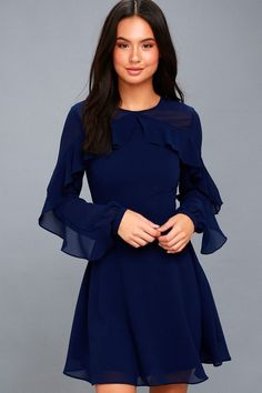 Lulus Exclusive! The Longtime Love Navy Blue Long Sleeve Skater Dress is your party companion! Slightly sheer woven fabric sweeps across a rounded neckline into long, ruffled sleeves with button cuffs. Princess-seamed bodice and fitted waist meet a flirty skater skirt. Hidden back zipper.