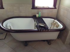 Bathtub Caddy Shelf, made from wooden sticks used for years in hanging tobacco.