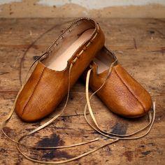 Early medieval. Haithabu (Germany), 10th century. Turnshoes type 9 from «Die Lederfunde von Haithabu». One piece shoes decorated upper with…