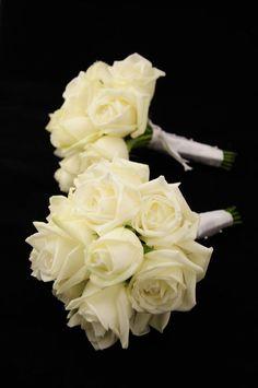 White bridesmaid's boquets. I like the idea of white boquets for the bridesmaids and red for the bride.