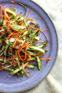 Asparagus Mint Slaw-- Raw asparagus, carrots, and radishes get tossed with fresh mint and vinegar in this bright and crunchy slaw.