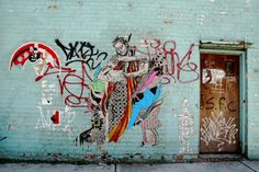 """SWOON is a street artist from New York City who specializes in life-size wheatpaste prints and paper cutouts of figures. Swoon studied painting at the Pratt Institute in Brooklyn and started doing street art around 1999. Swoon does not release her real name to the public to avoid prosecution for the crime of """"vandalism"""" associated with street art."""