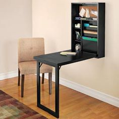 foldable wall desk. Very neat!! Put a picture on the bottom of the desk so when folded up looks like a framed picture on the wall! Clever Idea!! Wonder if we could make this?