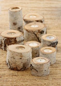 Don't usually like the rustic look, but these Birch Candle Holders are a cute centerpiece idea!