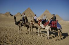 Going camel-riding around the pyramids with my hubby, and great friends Don & Margo. We walked all over Egypt - it's a great place to do that.