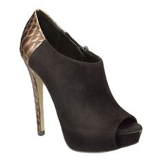 """As seen in the November issue of Self Magazine.....peep toe 5.25"""" bootie with back detailing.  Covered 1.5"""" platform.  Side zipper closure.  Leather upper."""