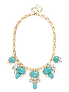 Natural turquoise stones get the glam treatment with crystal details and gold hardware for a gorgeous, down-to-earth statement piece.