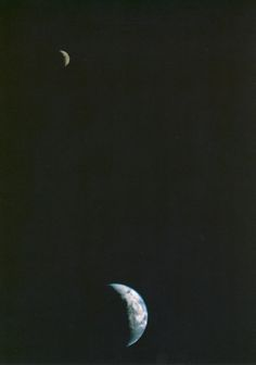 Earth and Moon as seen by Voyager, the first of its kind ever taken by a spacecraft, recorded on September 18, 1977