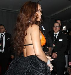 Rihanna wearing a beaded orange crop top on the red carpet at the 59th Annual GRAMMY Awards 2017 held at the Staples Center in Los Angeles on February 12, 2017