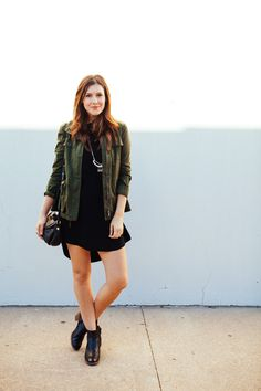 utility jacket, black dress, bare legs + black ankle boots