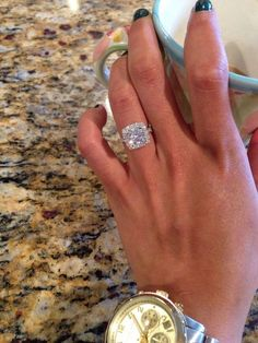 What a 2.5 carat round cut diamond looks like on a Gabriel & Co. halo setting. This gorgeous engagement ring is a favorite! The skinny shiny band makes the chunky center diamond pop! The 2.5 carat means a lot of brilliant shine in a compact size.: